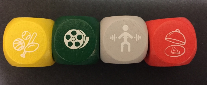 colored dice with images signifying various activities
