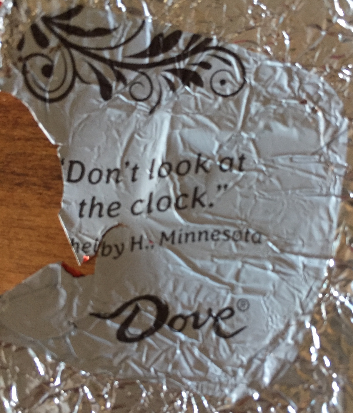 Dove chocolate wrapper with message of 'Don't Look at the Clock'.