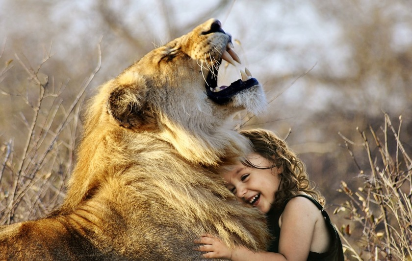 girl hugging lion