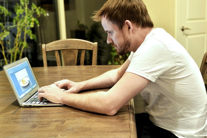 Man intently working at a laptop