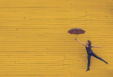 woman-suspended umbrella